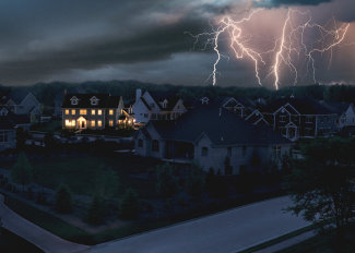 A large home has power from a generator during a city-wide power outage.